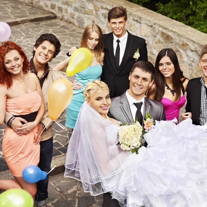 Happy newlyweds with friend